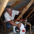 Inspector in roof cavity