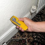 Testing dampness in a wall